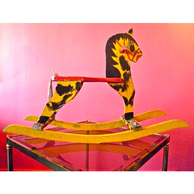This rocking horse was made totally with LOVE and played with and still strong & rocking!!! just look at it ... words...