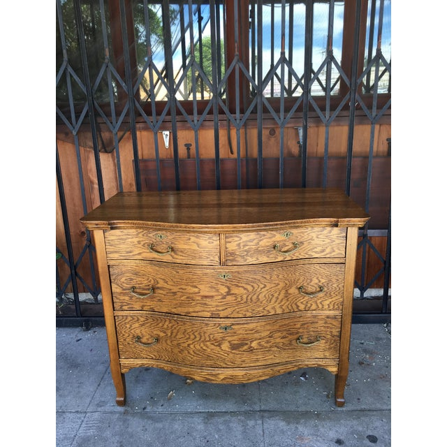 Antique dresser with 4 drawers, would fit perfect in any home.
