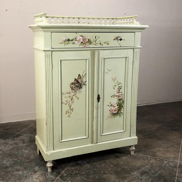 Antique Painted Cabinet is a delightful example of Belle Epoque charm featuring a superlative architecture and its...