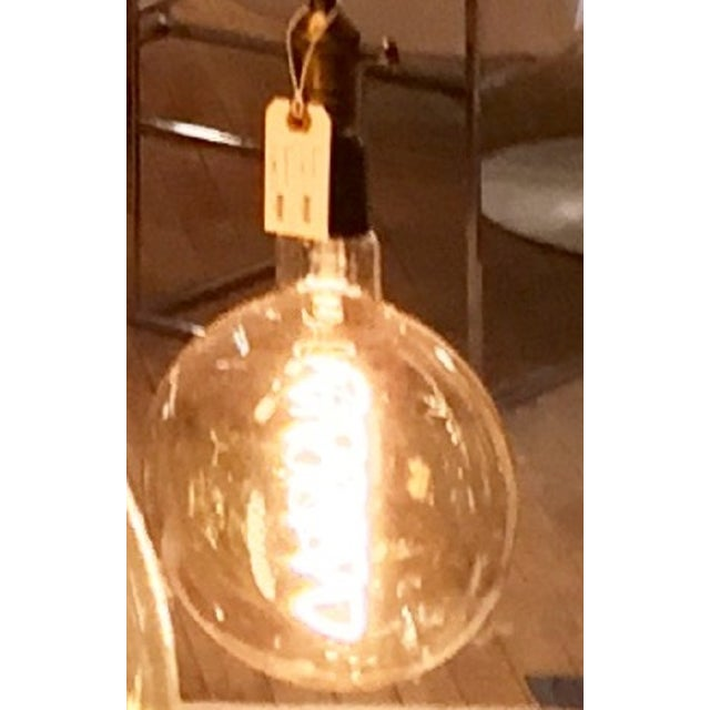Are you working on a historic or vintage antique light project? This globe style light bulb which you'll find works well...