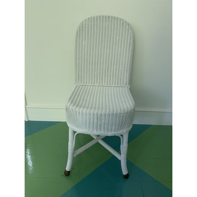Pair of vintage Lloyd Loom wicker chairs. Found at vintage store in Los Angeles. Not original paint, professionally...