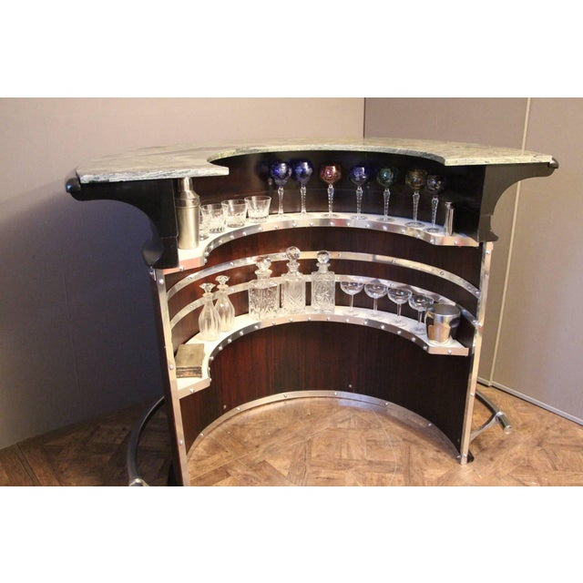 This magnificent bar is very comfortable with its half moon shape, its green marble top and its shelves inside. It...