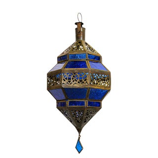 Handcrafted Moroccan Metal and Blue Glass Lantern in Octagonal Diamond Shape For Sale