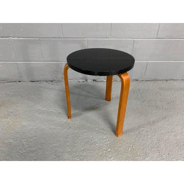 Alvar Aalto stool manufactured by Artek, originally designed in 1933. Crafted in Laminated Birch. Retails warm, rich,...