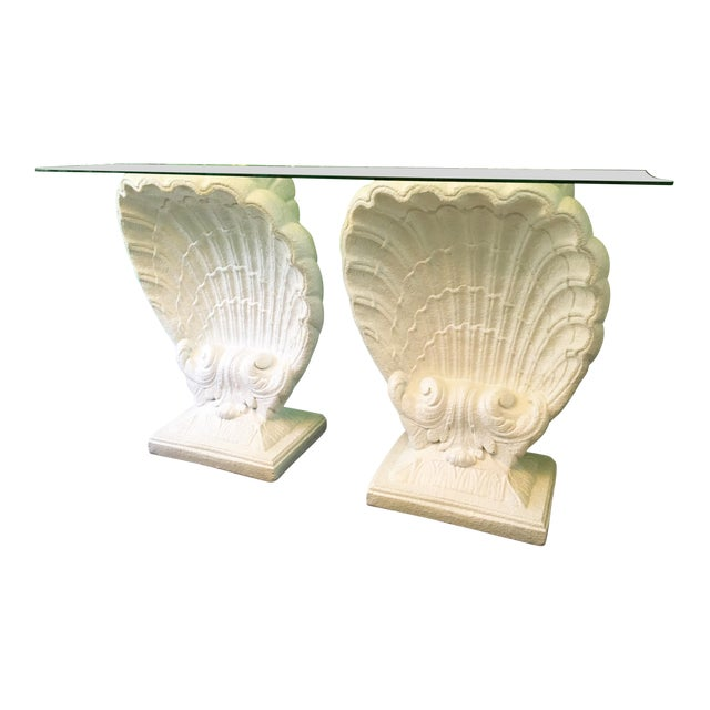 Sculptural shell form table in the manner of Grosfeld House features twin shell bases with beveled glass top. Bases are a...