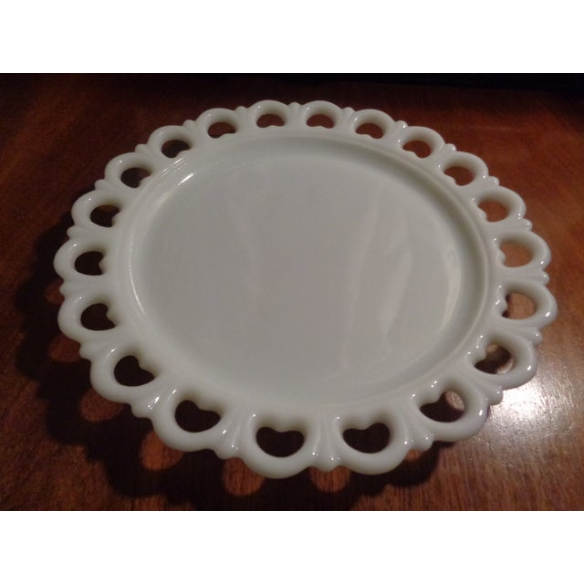 Pretty mid century large round milk glass cake plate/serving platter with reticulated rim. No maker's mark. This tray...