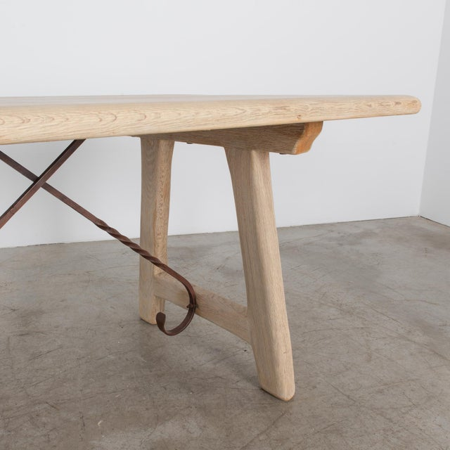 This Belgian style table from the 1950's imitates an older Spanish style, rendered in oak. Popular style in mid-20th...
