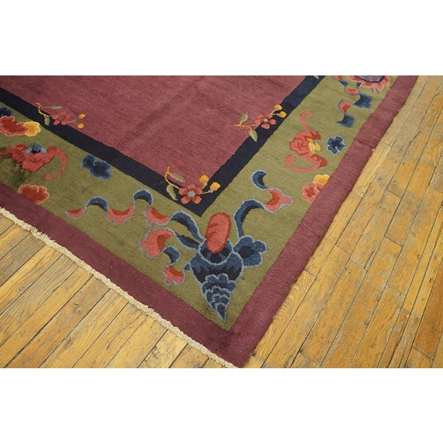 Antique Chinese Art Deco Rug with a purple background.