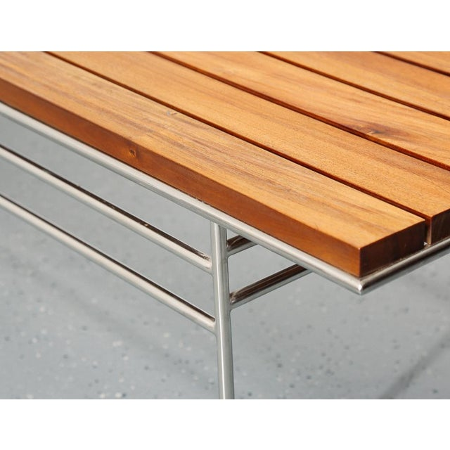 Outstanding quality mid century Danish modern decor solid oiled wood slat bench. Solid stainless steel rod base...