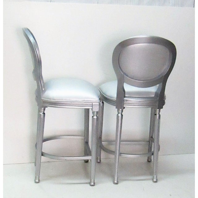Pair of Vintage Barstools completely refinished to Modern. The wood has been finished in a metallic Silver Paint and the...
