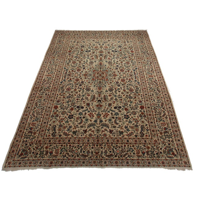This is a hand knotted wool Persian Kashan rug with an intricate floral design.