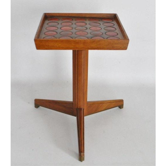 This is a rare signed Edward Wormley for Dunbar Natzler tile top drink stand. The piece is from the 1950s.