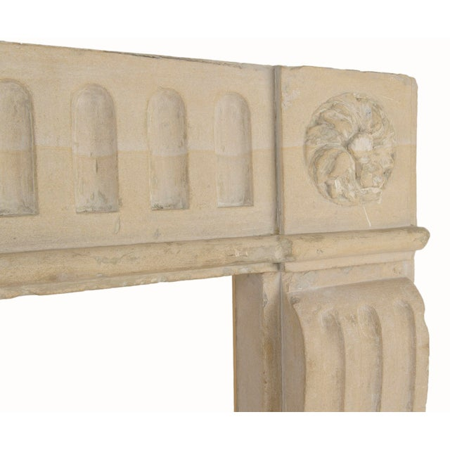 Charming Louis XVI period French limestone surround. Made in the early 18th century.