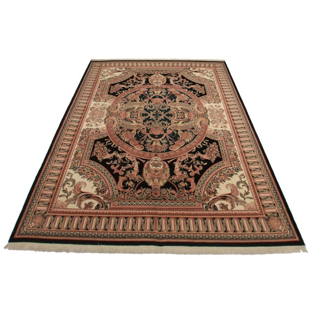 This is a fine, hand knotted wool Pakistani rug with a French Aubusson design.