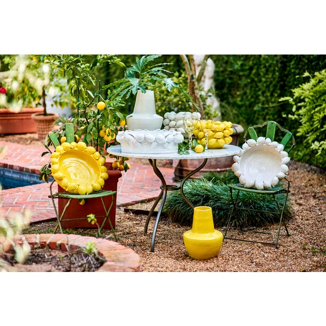 This is a large decorative planter that has many uses. It functions as a planter, centerpiece, or just a decorative accent...