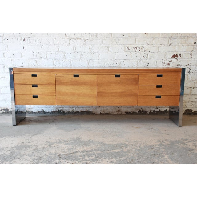 An outstanding Mid-Century chrome and mahogany credenza designed by Roger Sprunger for Dunbar's executive collection. The...