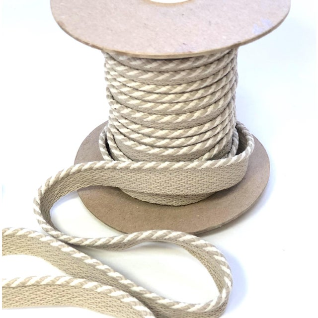 """One 10.9 yard spool of 1/4"""" braided cord with flange. Cord colors are white and sand. Flange is 1/2"""" wide for sewing...."""