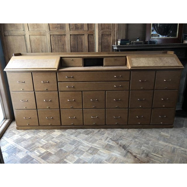 Stunning LARGE oak file cabinet counter. Came out of an old bank building. Just under 9FT long. Solid oak construction....