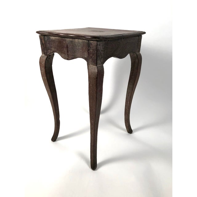 A small and stylish Louis XV style side table, the walnut nearly square top with molded serpentine edge in the front...