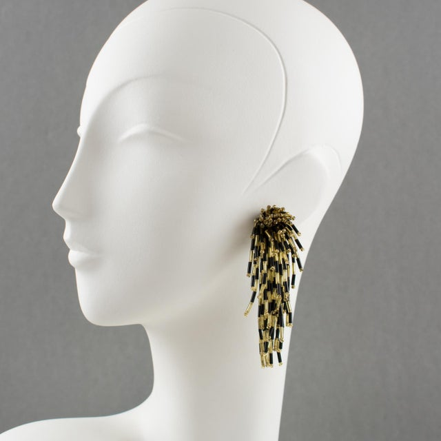 Stunning 1980s dangling glass clip on earrings with lion-fish shape. Oversized shoulder duster design with cascading...