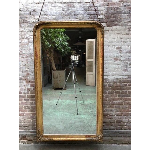 19th century mirror, gold leaf gilded in the style of Louis Philippe, Provenance France. This 19th Century Mirror is...