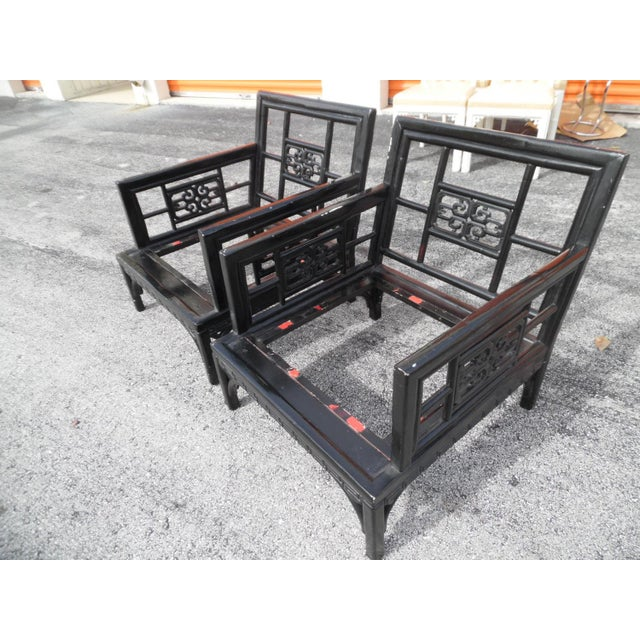 This is an interesting pair of Asian lounge chairs. They feature a wrap around border of Greek Key detailing as well as...