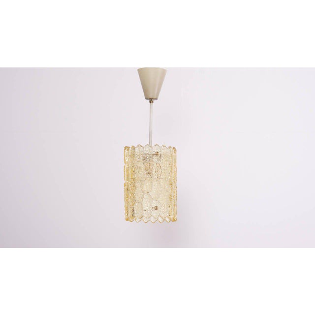 Two pieces of pressed yellowish glass, that lamp was designed by Carl Fagerlund for Orrefors. Height shown includes rod...