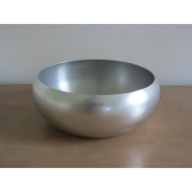 A stunning pair of 1930s spun aluminum bowls by noted industrial designer Lurelle Guild for Kensington, Inc..