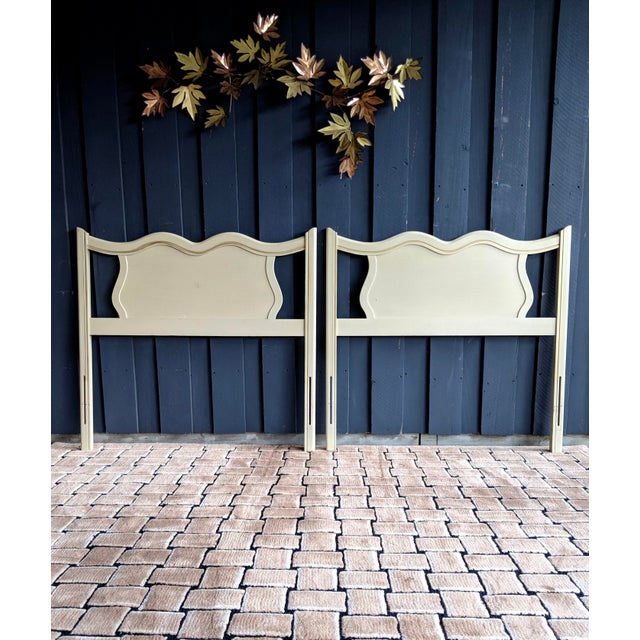 Absolutely darling pair of carved wood French Provincial headboards in creamy ivory finish with light gold detailing at...