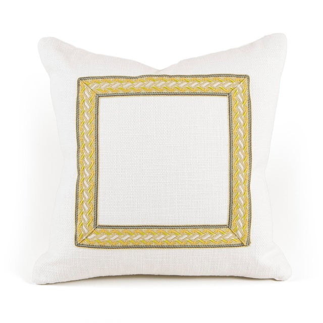 """Fresh white woven, square 16"""" pillow with braided trim detail with citrine, blue, white and taupe accents. The pillow is..."""