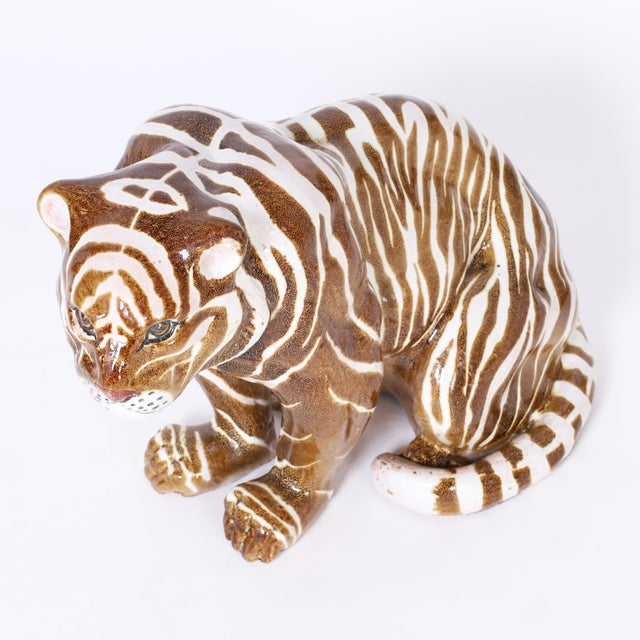 Mid century tiger sculpture or object of art crafted in terra cotta, decorated with brown and white stripes and glazed.