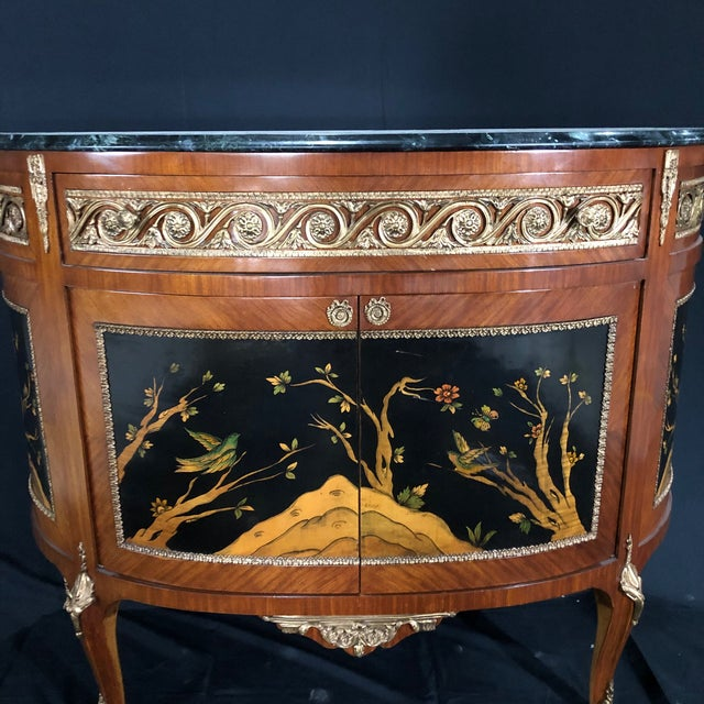 Incredible French Louis XV style demilune console cabinet having mahogany and walnut inlaid figural scenes depicting birds...