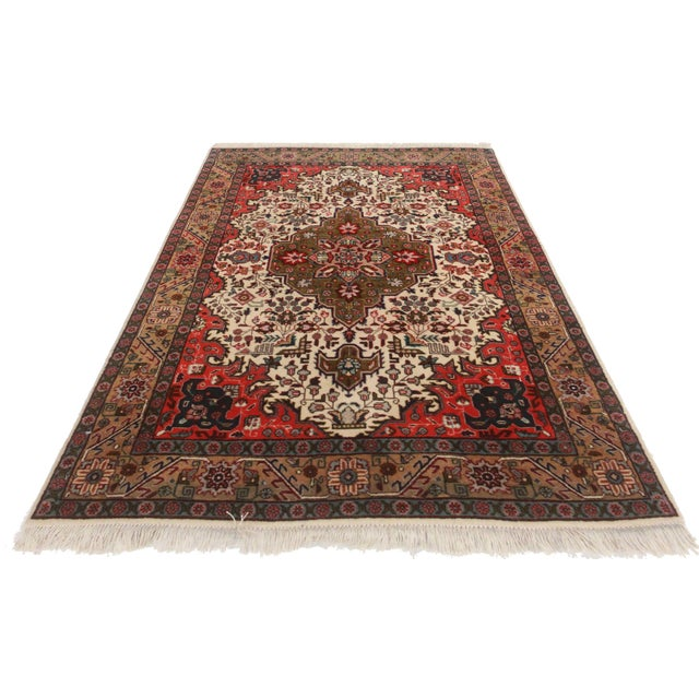Hand knotted wool Persian Tabriz Rug with a beautiful medallion design.