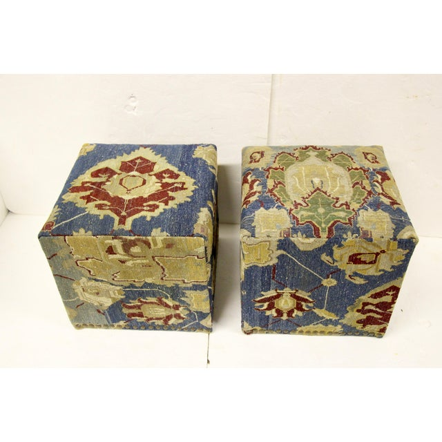 Pair of waterfall-style cube stools. Newly constructed wood frames upholstered in an antique hand-knotted Persian rug....
