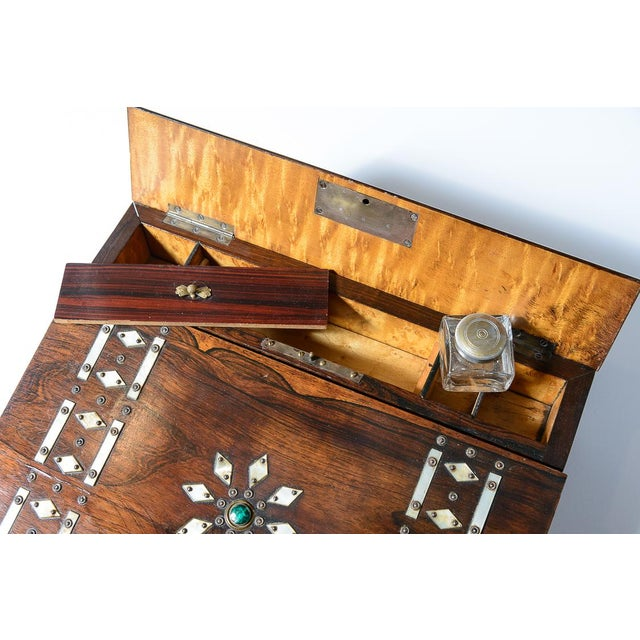 C.1860, Rosewood, mother of pearl, and malachite writing slope with maple interior. Key included.