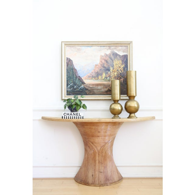 This is an unusual vintage piece made of pencil reed rattan, in the style of Gabriella Crespi. The table has a beautiful...