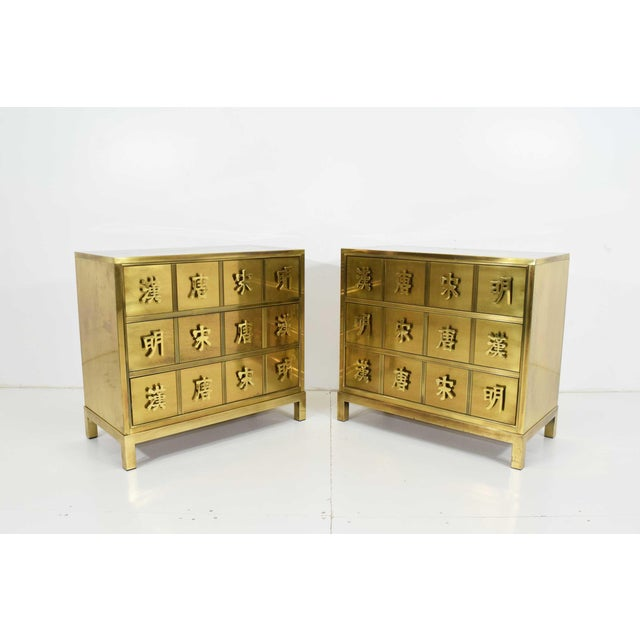 A fine pair of Hollywood Regency style mastercraft commodes, chests or nightstand in wood and brass veneer depicting the...