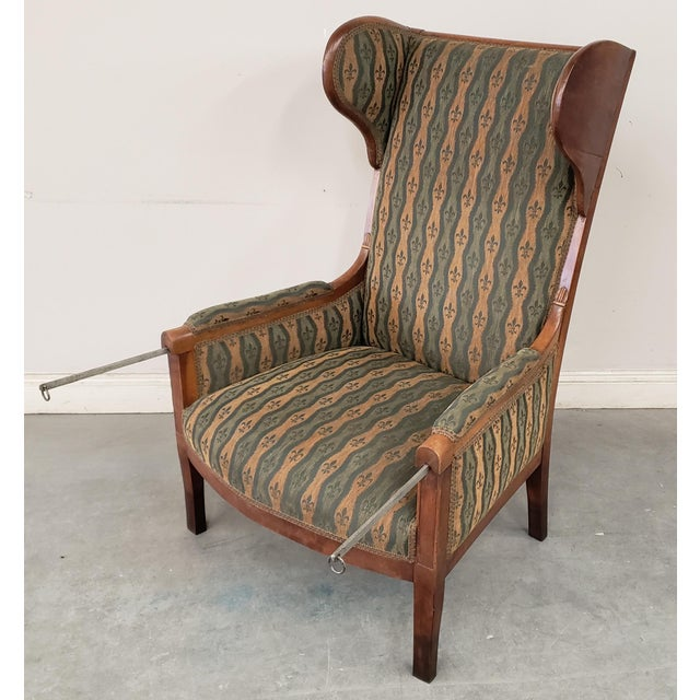 Up for sale is an Early 20th Century French Country Provincial Upholstered Maple Wood Wingback Armchair! The wood frame is...