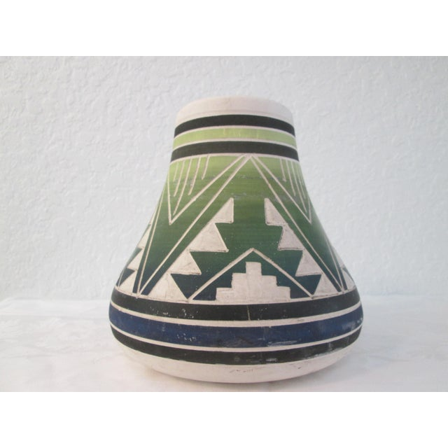 Stunning large vintage South Dakota American Indian pottery vase featuring a traditional design around perimeter hand-...
