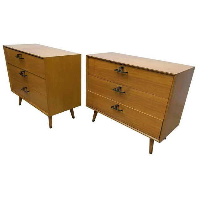 Pair of Mid-Century Modern bachelor chests, commodes, nightstands or dressers. A finely constructed pair of three-drawer...