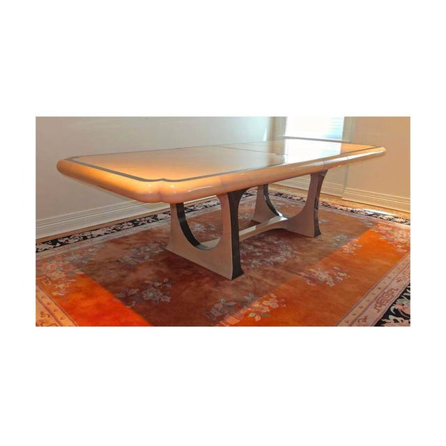 Arrestingly beautiful lacquered goatskin expandable dining table by Enrique Garcez of Colombia. Cream colored parchment...