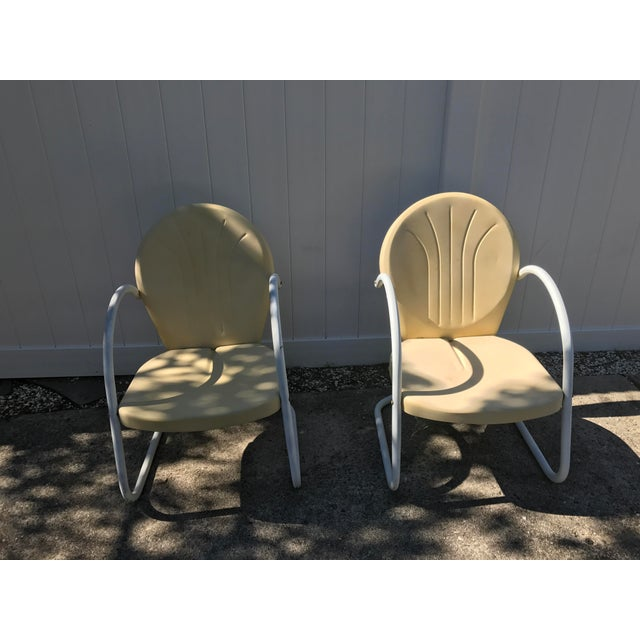 Steel lounge chairs, four seats available for $200 each. Original antique 1940's outdoor chairs in excellent condition.