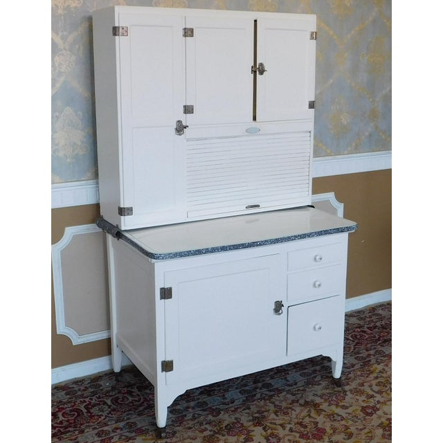 Description: This is a very good looking antique repainted white Sellers Hoosier kitchen cabinet, c1890. Painted white...