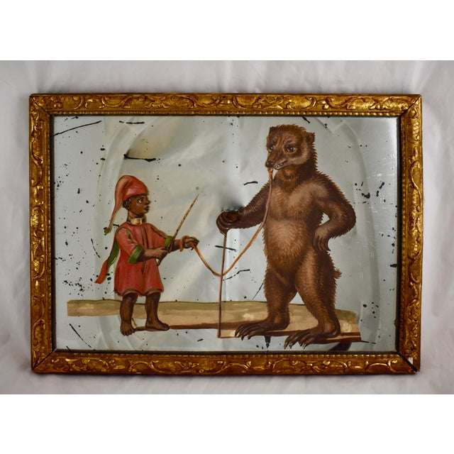 A 19th Century French exotic themed, hand-painted, decoupaged and mirrored depiction of a young animal trainer and his...
