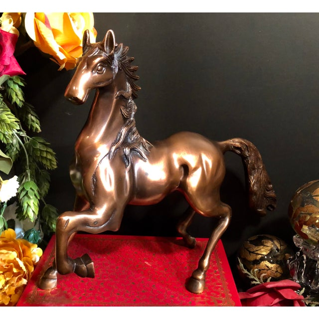 """This is for a beautiful horse that measures 11""""tall and is Brass that has a Copper Plate over it. The copper glistens and..."""