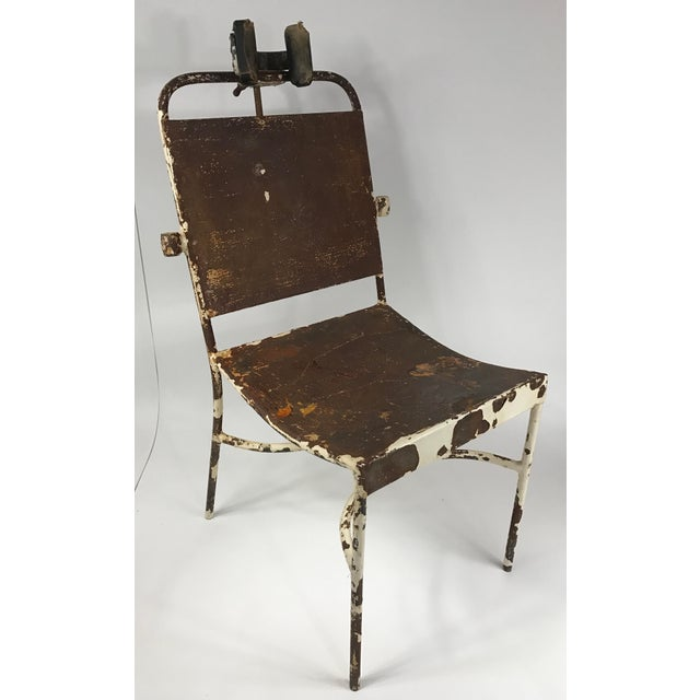 Interesting and unique antique medical exam chair. Original untouched condition showing metal frame through distressed...
