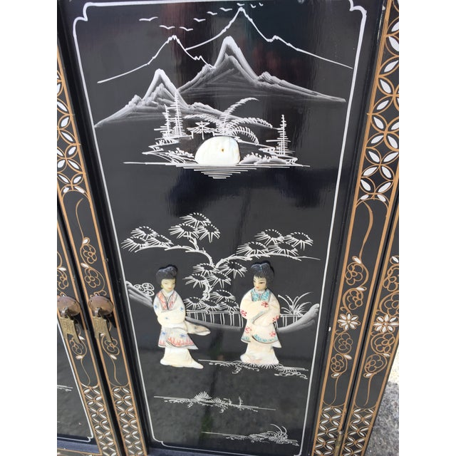 Inlaid with hard stone and mother of pearl traditional scenes. Vibrant colors and painted accents on the cabinet and...