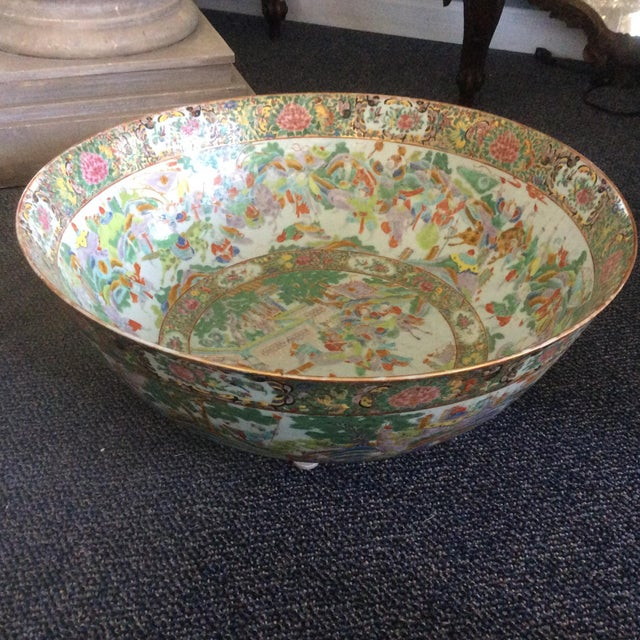 Beautiful large rose canton with lots of green and an old staple repair to the rim. This is a stunning large bowl and...