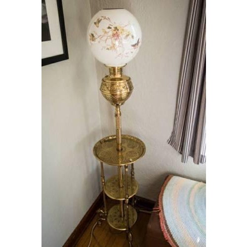 This fantastic 1800's brass triple shelf floor oil lamp is in outstanding condition for its antique age. The owner shared...