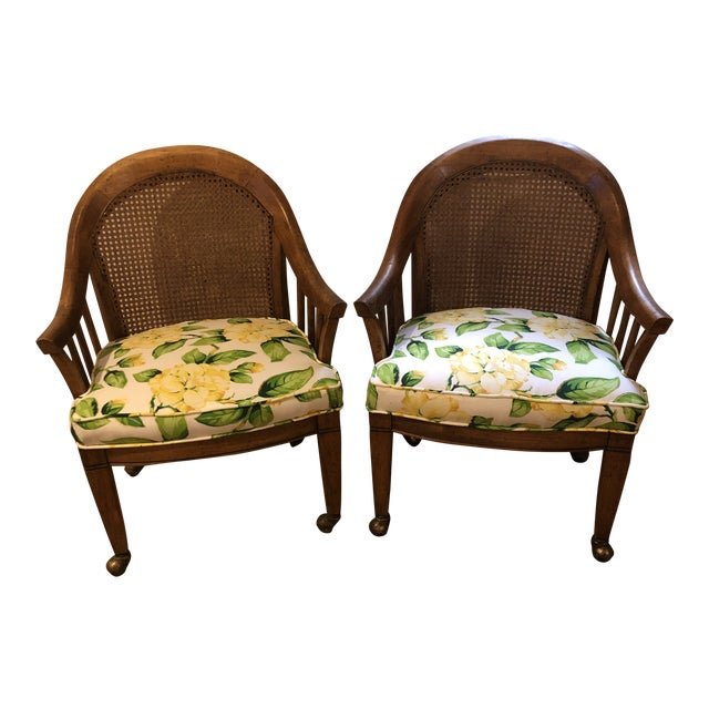Mid Century Cane Back Rolling Chairs - a Pair For Sale